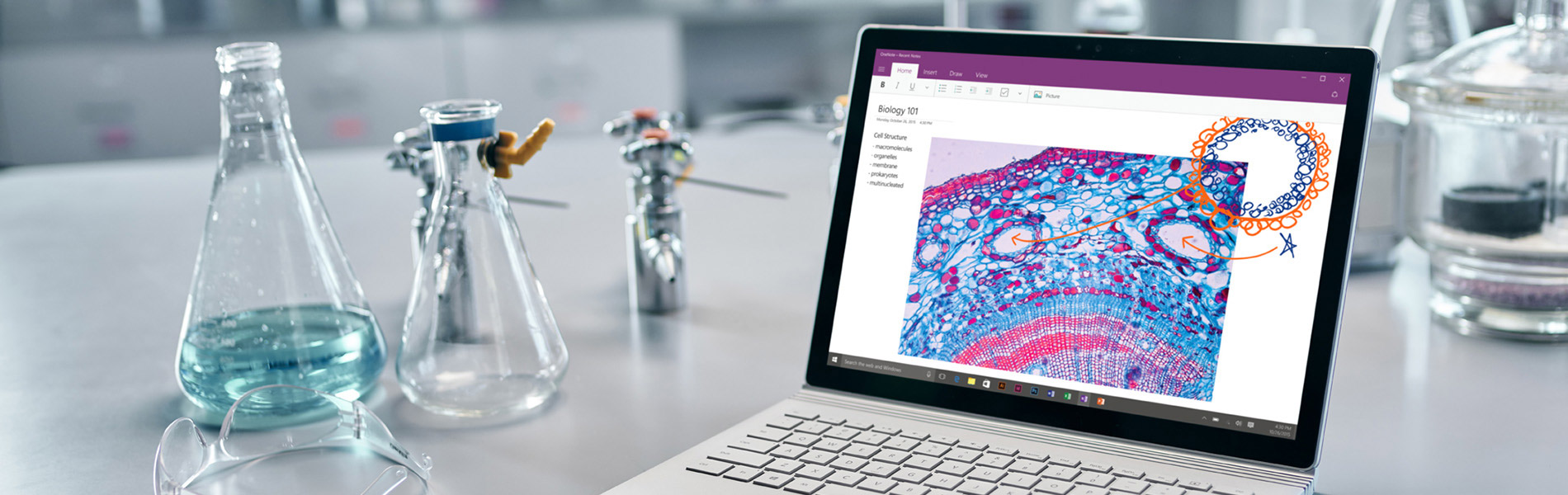 An image of a laptop using onenote in a science laboratory