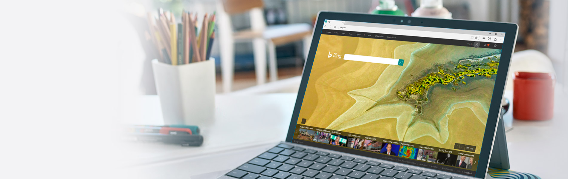 Image of a Surface tablet on a table with the Bing search engine on the screen