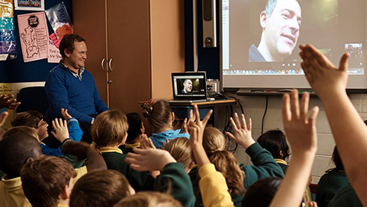 Classroom of students on a Skype call with a professional