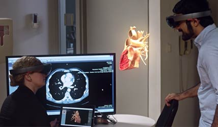 man and woman using virtual reality headset to see the human body
