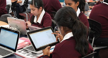 click on this Image of Children using laptops in a classroom to view the showcase story for botany downs school