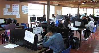 click on this Image of a large computer room, filled with students to view their showcase story