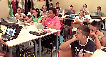 click on this image of young students answering questions and using laptops to watch a video about Istituto Comprensivo Baccio da Montelupo