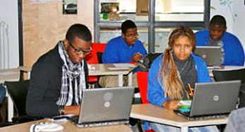 click on this Image of students studying with their laptops at the School of the Future to view their showcase story