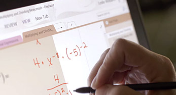 An image of a person using a stylus on the Surface to take mathematical notes in OneNote.